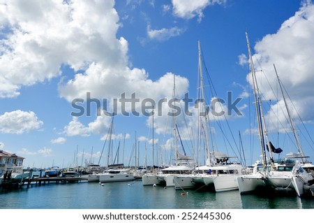 Yachts in caribbean port - stock photo
