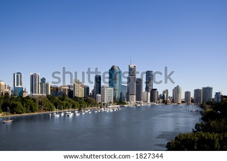 yachts in front of brisbane city skyline on a sunny day