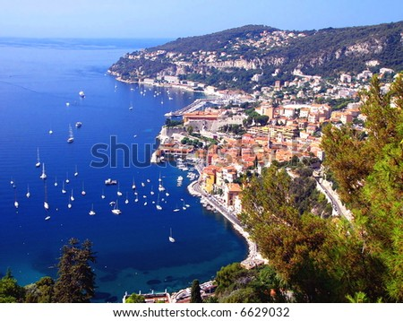 Yachts in the light-blue sea. - stock photo