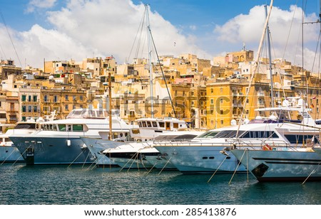 yachts in Valleta port on the background of the city in Malta - stock photo