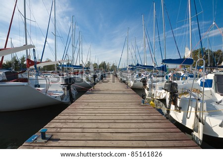 Yachts moored by the jetty - stock photo