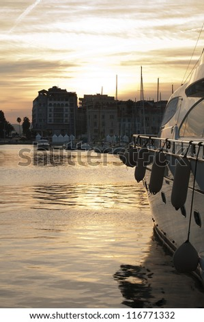Yachts moored in Cannes at sunset. Cannes bay - stock photo