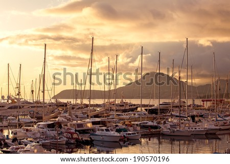 Yachts moored in the bay in the rays of the sunset. Montenegro, Bar. - stock photo