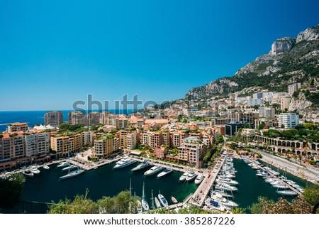 Yachts moored near city Pier, Jetty In Sunny Summer Day. Monaco, Monte Carlo architecture. - stock photo