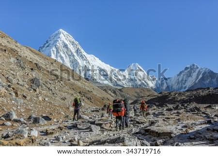 Yaks caravan on the trek at the foot of Mount Everest (8848 m) near Gorak Shep village - Nepal, Himalayas - stock photo