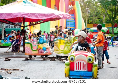 YALA, THAILAND - SEPTEMBER 26: Unidentified students play on playground in Cave Temple Buddhism Day on September 26, 2011 at Cave Temple Yala, Thailand