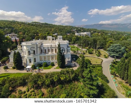 YALTA - AUG 29: Green trees around the Livadia Palace on August 29, 2013 in Yalta, Ukraine. View from unmanned quadrocopter. - stock photo