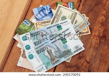 YALTA, CRIMEA, RUSSIA - DECEMBER 27, 2014: US dollars bills ,russia ruble and Visa credit card on December 27, 2014 in Yalta, Russia - stock photo