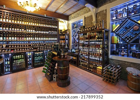 YALTA, REPUBLIC OF CRIMEA, RUSSIA - AUG 14, 2014: Interior and assortment drinks wine shop with traditional Crimean wines, nobody - stock photo