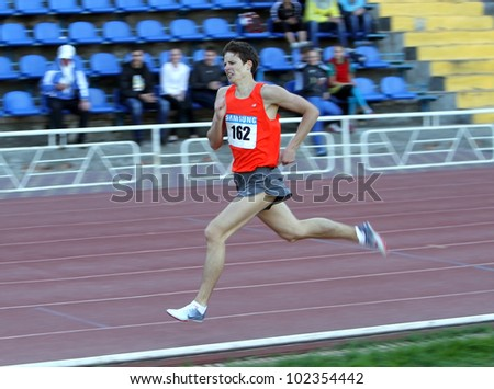 YALTA, UKRAINE - APRIL 25: Karpenko Aleksandr - the winner of 1500 meters race for boys age 16-17, on Ukrainian Junior Track and Field Championships on April 25, 2012 in Yalta, Ukraine. - stock photo