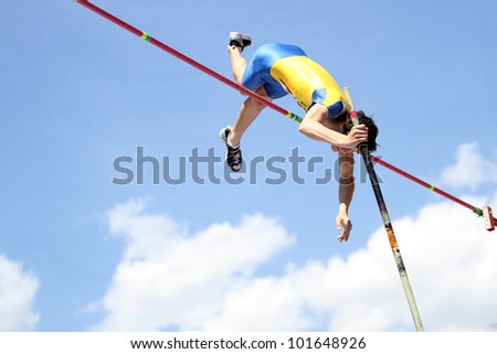 YALTA, UKRAINE - APRIL 25: Kiril Kiru compete in the pole vault competition for boys age 16-17 on Ukrainian Junior Track and Field Championships on april 25, 2012 - Yalta, Ukraine. - stock photo