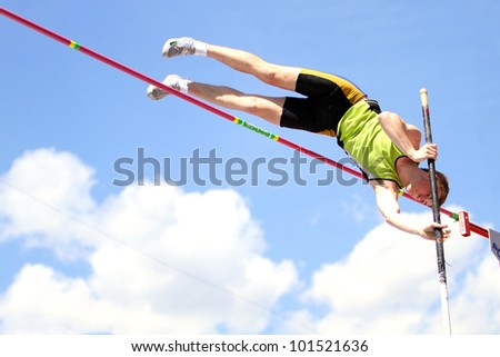 YALTA, UKRAINE - APRIL 25: Telesenko Vladimir compete in the pole vault competition for boys age 16-17 on Ukrainian Junior Track and Field Championships on april 25, 2012 - Yalta, Ukraine. - stock photo