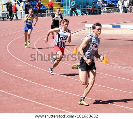 YALTA, UKRAINE - APRIL 25 : Unidentified boys age 16-17 on the 400 meters race on Ukrainian Junior Track and Field Championships on April 25, 2012 in Yalta, Ukraine - stock photo