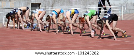 YALTA, UKRAINE - APRIL 25: Unidentified girls age 16-17 on the start of the 100 meters race on Ukrainian Junior Track and Field Championships on April 25, 2012 in Yalta, Ukraine.