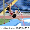YALTA, UKRAINE - MAY 24: Parlak Demet from Turkey competes in pole vault competition for girls +17 on the international athletic meet Ukraine - Turkey - Belarus on May 24, 2012 in Yalta, Ukraine. - stock photo