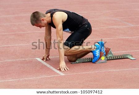 YALTA, UKRAINE - MAY 24: Pozhar Dmitro on the start at the 400 meters race on the international athletic meet between Ukraine, Turkey, Belarus on May 24, 2012 in Yalta, Ukraine. - stock photo