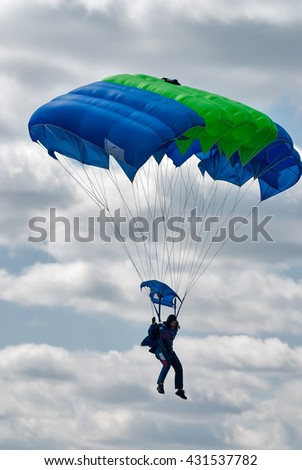 Yalutorovsk, Russia - May 24, 2008: Sport airdrome. Paratrooper woman descends and trains in landing accuracy - stock photo