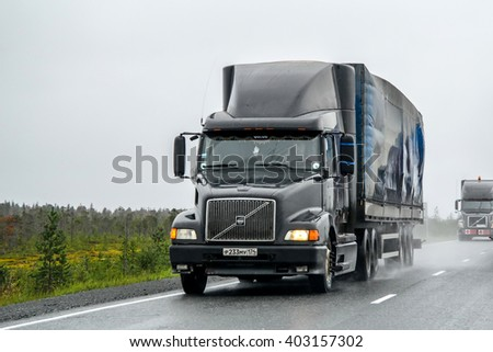 YAMAL, RUSSIA - AUGUST 5, 2012: Semi-trailer truck Volvo VNL64T at the interurban road. - stock photo