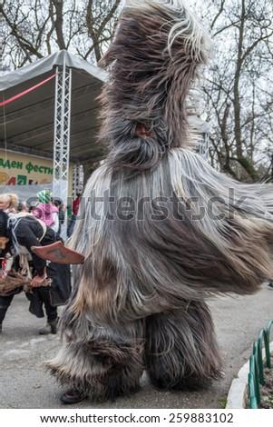 YAMBOL, BULGARIA - MARCH 08, 2015 - Kukerlandia - mask festival and masquerade games 08 March 2015. Bulgarian traditional dances and costumes called Kukeri. - stock photo