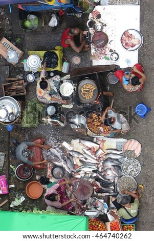 YANGON, MYANMAR - JULY 23, 2016 : Yangon Chinatown street market, lots of food, fruit, vegetable, fish, meat, pork in Chinatown, Yangon, Myanmar