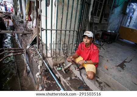 YANGON, MYANMAR - JUNE 12 2015: Developing new infrastructure on one of the hottest recorded days before monsoon season in Yangon, Myanmar. - stock photo