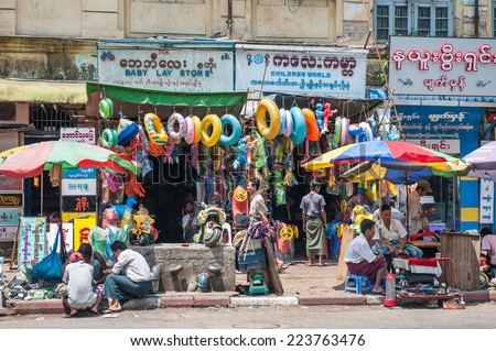 Yangon, Myanmar - March 24,2011: View of trading zone in down town of the city of Yangon, Myanmar. Yangon is the biggest city in Myanmar with population over 4 million people. - stock photo