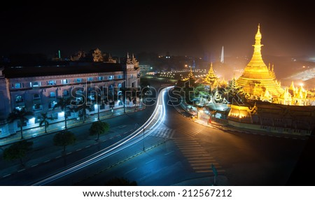 Yangon Myanmar, night cityscape with Sule pagoda  - stock photo