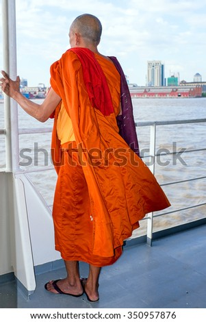 YANGON, MYANMAR - november 24, 2015: Monk on the ferry at Yangon, Myanmar. Buddhism in Myanmar is predominantly of the Theravada tradition, practised by 89% of the country's population. - stock photo