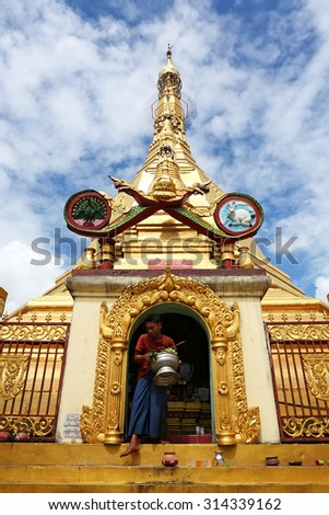 YANGON, MYANMAR - OCT 7: Unidentified people come to pray at  Sule Pagoda on October 7, 2012 in Yangon, It is a landmark of Sule Pagoda located in the heart of Yangon - stock photo