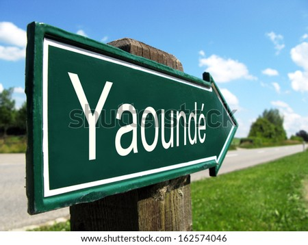 Yaounde signpost along a rural road