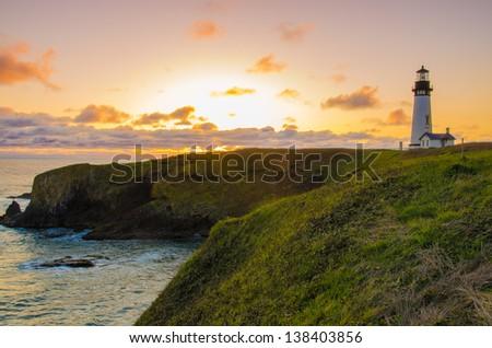 Yaquina Head lighthouse by the Oregon Coast on a beautiful sunset - stock photo