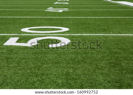 Yard Lines of a Football Field from the Fifty - stock photo