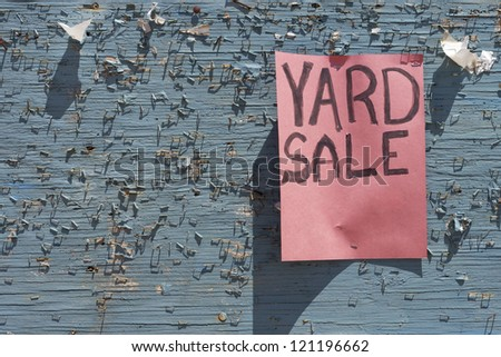 Yard sale sign posted on weathered community board (empty space for your text) - stock photo