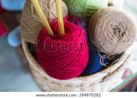 yarn in wicker basket, Colorful yarn in wicker basket - stock photo