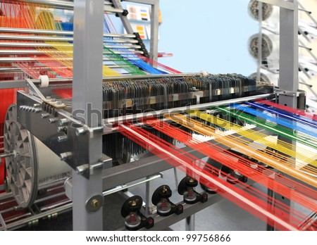yarn warping machine in a textile weaving factory - stock photo