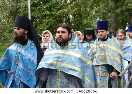 YAROSLAVL, RUSSIA - AUGUST 21, 2013: The procession at Holy Vvedensky the Tolgsky female monastery. Vvedensky Tolga convent. Orthodox women's monastery in Yaroslavl on the Volga left Bank. - stock photo