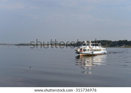 YAROSLAVL, RUSSIA - AUGUST 21, 2013: Yaroslavl is one of the oldest Russian cities, founded in the XI century.Ship sailing along the Volga.