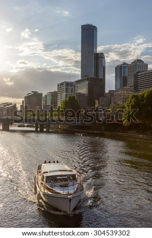 Yarra River cruise boat. Hire a luxury boat charter in Melbourne waterway, water taxis or wedding boat on special day in Summer at Sunset - stock photo