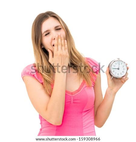 Yawn-beautiful young woman holding alarm clock  - stock photo