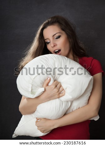 Yawn woman with pillow. Chalkboard background