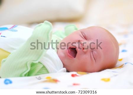 Yawning baby - stock photo