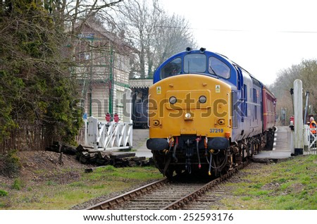 YAXHAM, UK - MARCH 20: A preserved ex British Rail class 37 diesel loco gives short rail trips to enthusiasts through rural Norfolk during the spring MNR diesel gala on March 20, 2011 in Yaxham - stock photo