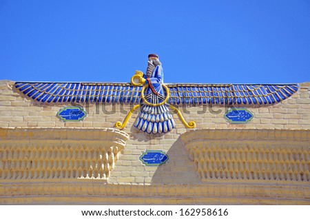 YAZD, IRAN � OCTOBER 13: Ahura Mazd statue on October 13, 2013 in Yazd, Iran. Ahura Mazda is described as the highest deity of worship in Zoroastrianism as creator the heavens and the earth. - stock photo