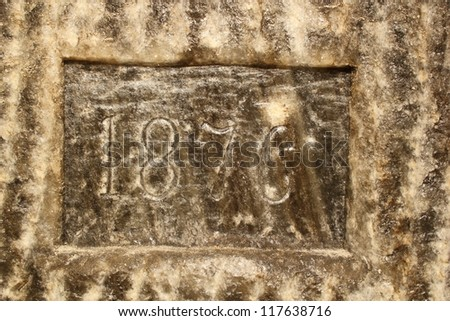year 1876 carved in salt on a salt mine wall, as the exploitation reached that level; as you climb down the stairs, you reach different levels marked on wall - stock photo