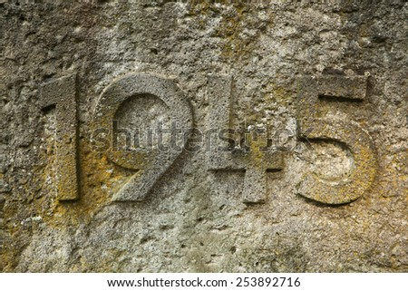 Year 1945 carved in the stone. The years of World War II. - stock photo