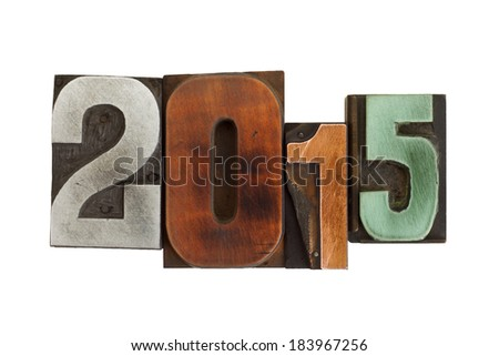 year 2015 in vintage metal and wooden letterpress type, scratched and stained, isolated on white background - stock photo