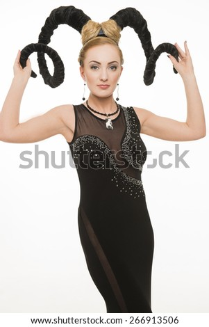 Year of a goat, the woman with horns - stock photo