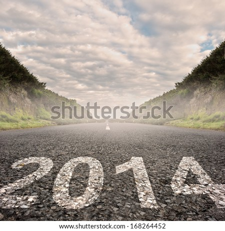 year 2014 painted on asphalt road - stock photo