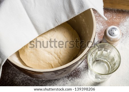 Yeast dough let stand to rise - stock photo