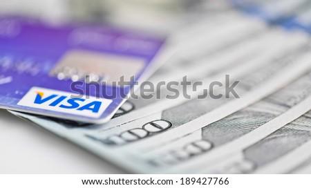 YEKATERINBURG, RUSSIA - APR 25, 2014: Visa Debit Cards Over Dollar bills  - stock photo